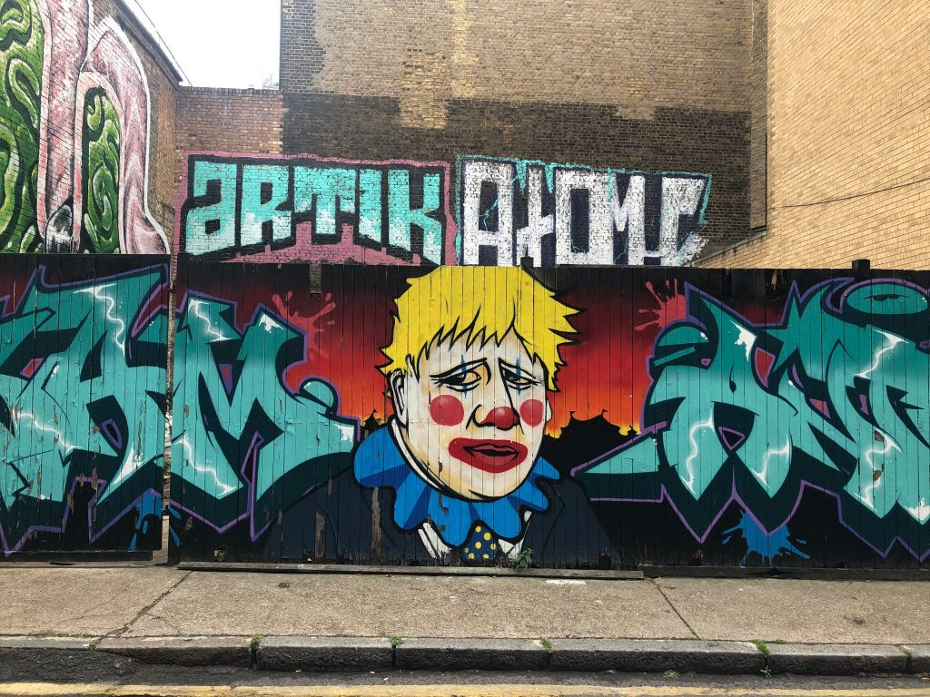 Brick Lane Graffiti Street Art - Boris Johnson UK Prime Minister Clown amid Covid 19 Pandemic NHS crisis